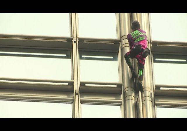 'French Spiderman' climbs Hong Kong building