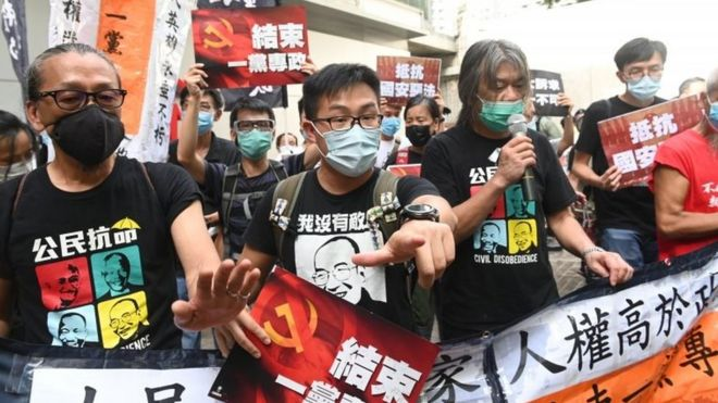 Hong Kong: First arrests under 'anti-protest' law as handover marked
